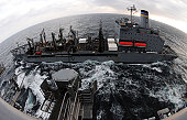 Pacific Ocean, April 2, 2011 - A fuel line is connected between the Military Sealift Command fleet replenishment oiler USNS Rappahannock (T-AO 204) and the aircraft carrier USS Ronald Reagan (CVN-76)