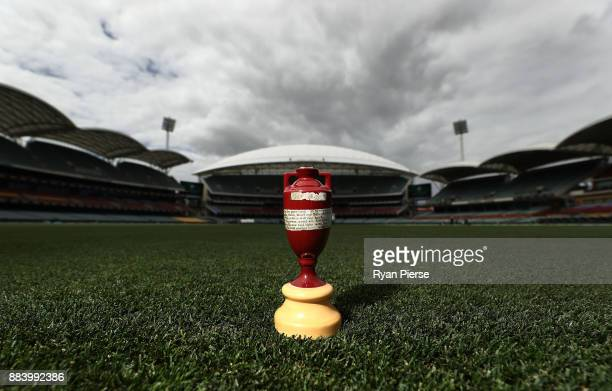 A replica Ashes Urn is seen on the ground beofre play during day one of the Second Test match during the 2017/18 Ashes Series between Australia and...