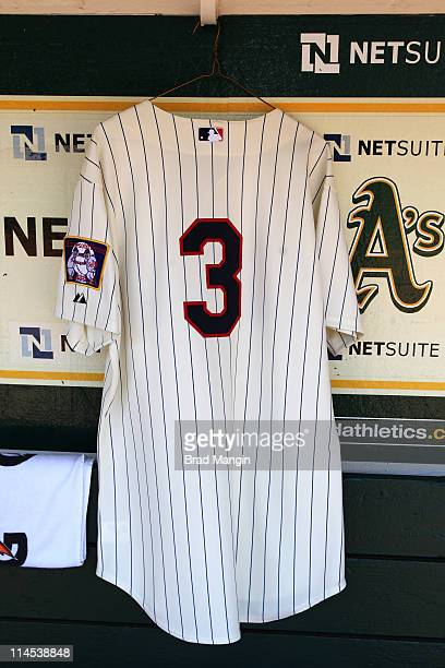 A replica Harmon Killebrew jersey of the Minnesota Twins hangs in the Twins dugout before the game between the Minnesota Twins and the Oakland...