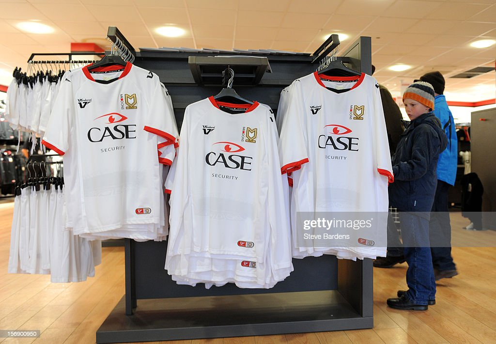 Replica MK Dons football shirts on sale in the club superstore at the Stadium MK before the npower League One match between MK Dons and Colchester United at Stadium MK on November 24, 2012 in Milton Keynes, England.