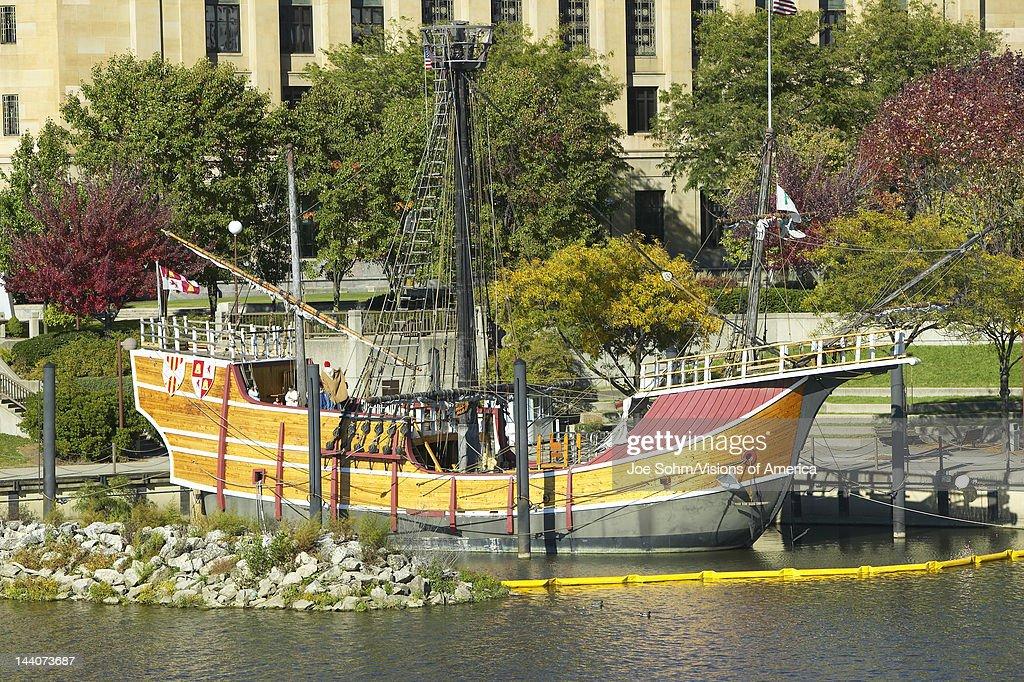 Replica of Columbus' ship the Santa Maria on Scioto River Columbus Ohio skyline in autumn