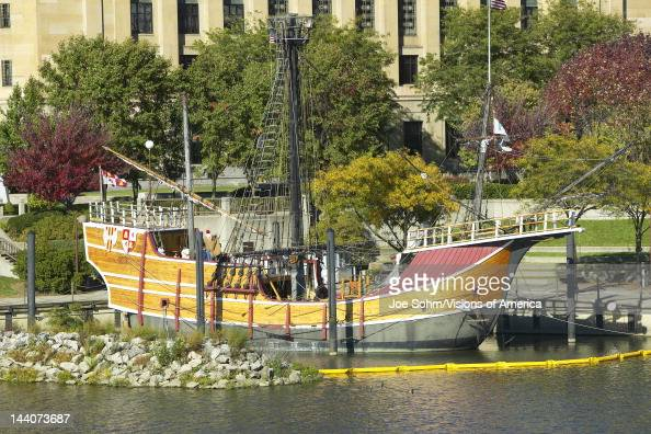 Replica of Columbus' ship the Santa Maria on Scioto River Columbus Ohio skyline in autumn