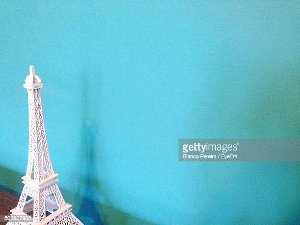 Replica Of Eiffel Tower Against Blue Wall