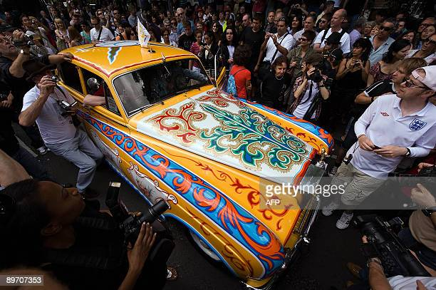 A replica of John Lennon's customised Rolls Royce car arrives on Abbey Road on August 8 2009 during an event to celebrate 40 years to the minute...