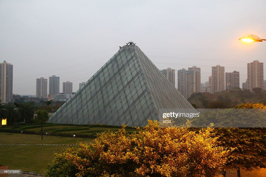 A replica of Louvre Pyramid is used as a sales office on November 16 2015 in Chongqing China A real estate developer built a glass pyramid which was...