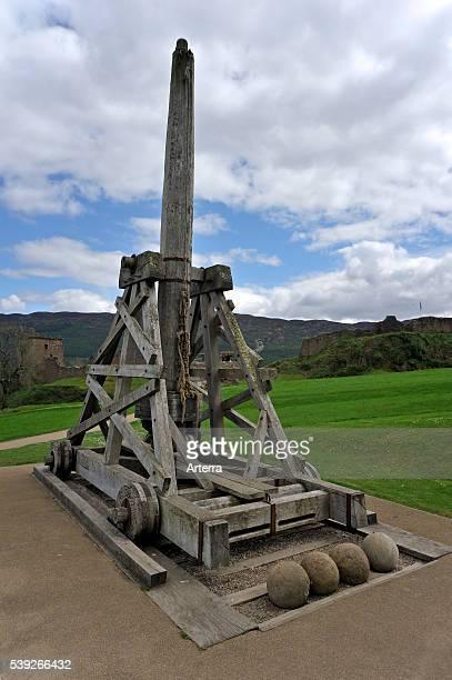 Replica of medieval wooden trebuchet / slingshot used for sieges near the ruins of Urquhart Castle beside Loch Ness near Drumnadrochit Scotland UK