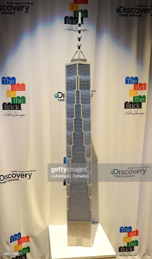 A LEGO replica of One World Trade Center by artist Nathan Sawaya is unveiled in New York, November 20, 2013. The scuplture was created by Sawaya following a contest 'What should Nathan build?' , in which he asked the public to suggest his next creation. The replica was unveiled as part of the final weeks of his exhibition 'The Art of Brick' which run until January, 5, 2014. AFP PHOTO/Emmanuel Dunand / AFP / EMMANUEL