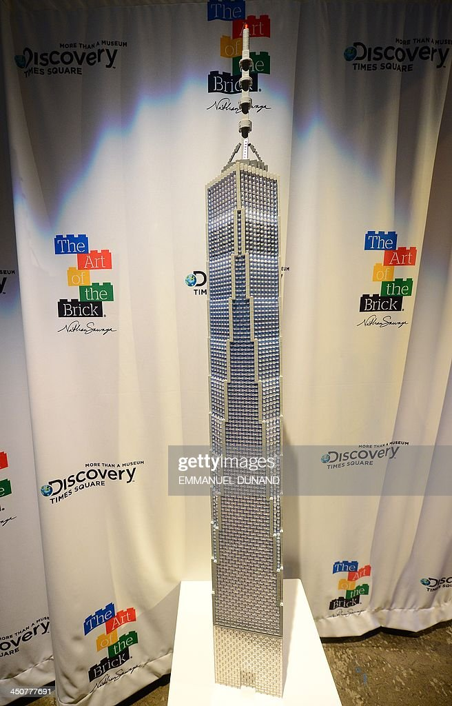 A LEGO replica of One World Trade Center by artist Nathan Sawaya is unveiled in New York, November 20, 2013. The scuplture was created by Sawaya following a contest 'What should Nathan build?' , in which he asked the public to suggest his next creation. The replica was unveiled as part of the final weeks of his exhibition 'The Art of Brick' which run until January, 5, 2014. AFP PHOTO/Emmanuel Dunand