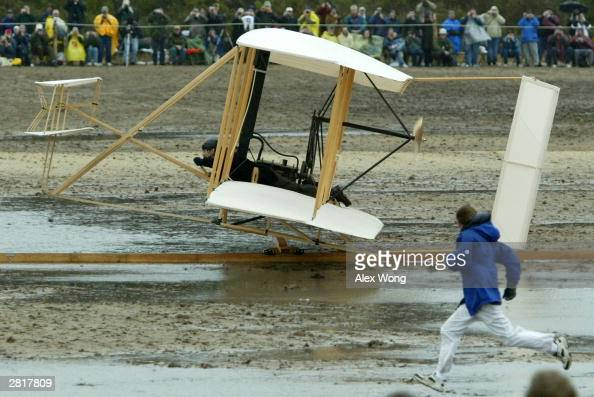 A replica of the 1903 Wright Flyer takes off from a track December 17 2003 during the Centennial Celebrations of the First Flight at the Wright...