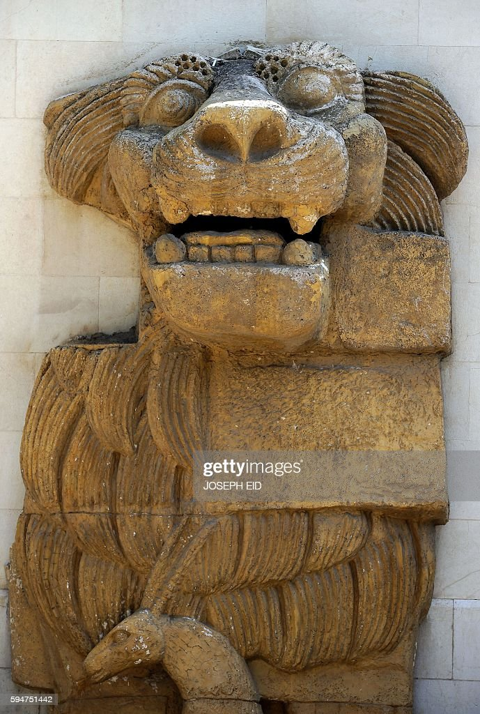 A replica of the Allat Lion from Syria's ancient oasis city of Palmyra which was destroyed by Islamic State group jihadists is seen in the garden of...