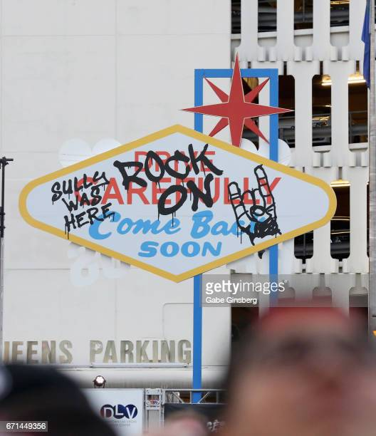 A replica of the backside of the Welcome to Fabulous Las Vegas sign with graffiti is displayed during the Las Rageous music festival at the Downtown...