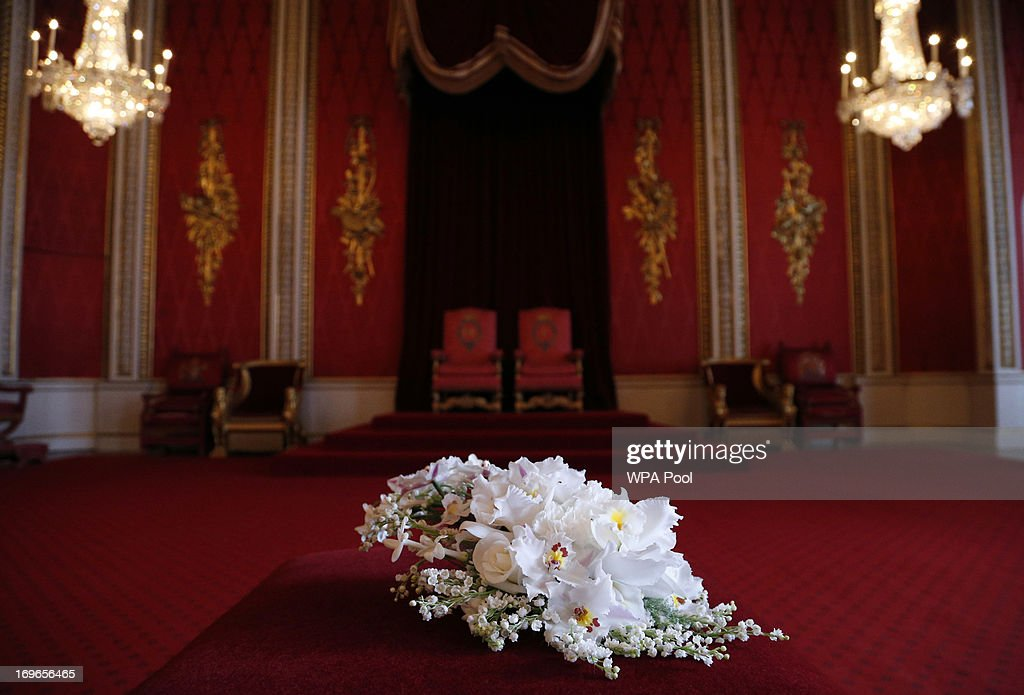 A replica of the Coronation Bouquet is presented to Queen Elizabeth II by the Worshipful Company of Gardeners in the Throne Room against the backdrop...