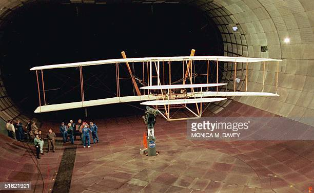 A replica of the historic 1903 Wright Flyer sits in a wind tunnel as members of the Wright Flyer project and NASA prepare to test the plane to learn...