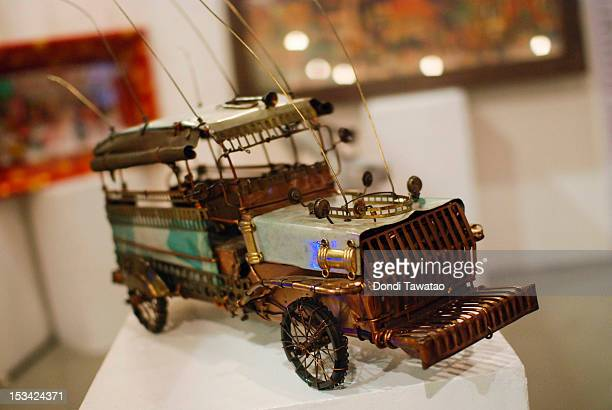 A replica of the iconic jeepney by Manila based artist Ral Arrogante made entirely of scrap iron and copper on October 5 2012 in Manila Philippines...