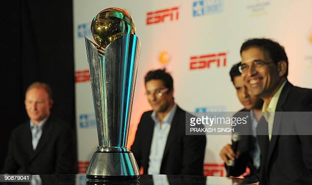 A replica of The International Cricket Council Champions Trophy on display as ESPN Star sports commentators Harsha Bhogle Sanjay Manjrekar Wasim...