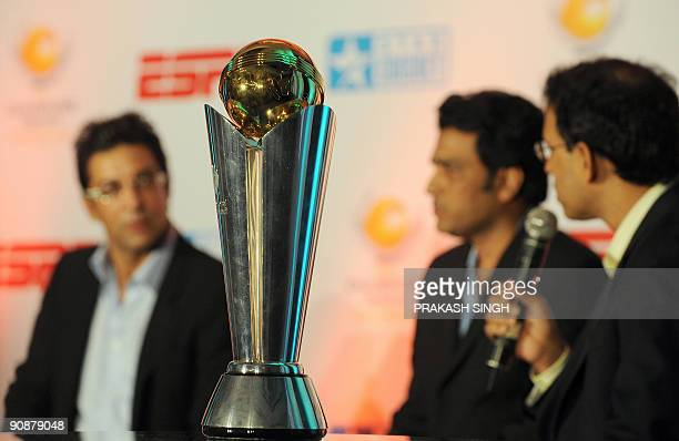 A replica of The International Cricket Council Champions Trophy on display as ESPN Star sports Commentators Harsha Bhogle Sanjay Manjrekar and Wasim...