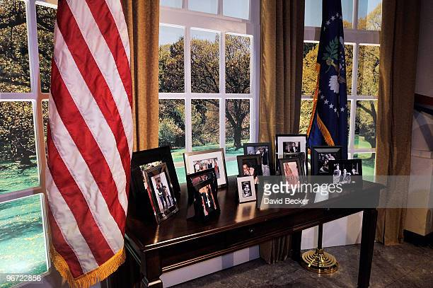 A replica of the Oval Office's credenza with pictures of President Barack Obama and his family during the unveiling at Madame Tussauds Las Vegas at...