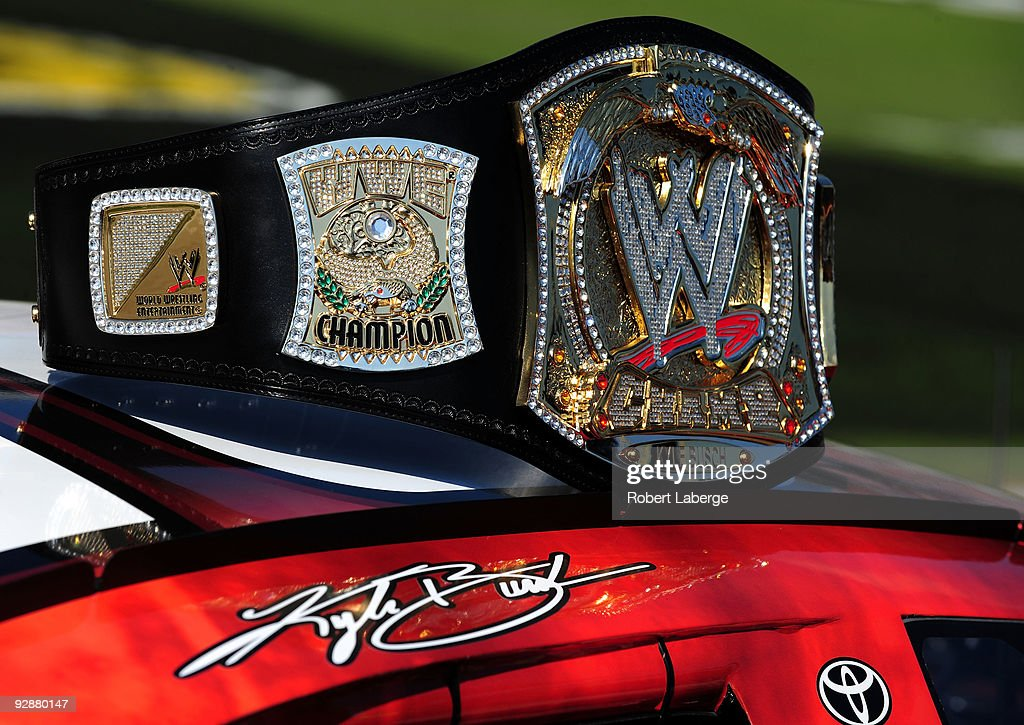 A replica of the WWE world championship belt rests on top of Kyle Busch's ZLine Designs/WWE Smackdown Toyota prior to the start of the NASCAR...