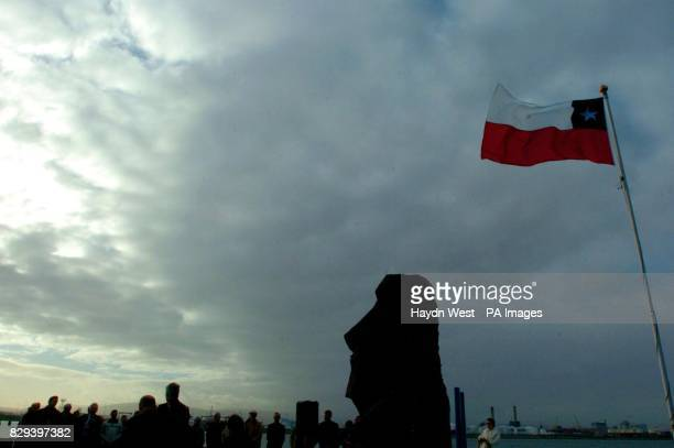 A replica statue of an 'Easter Island Moai' stands beneath the Chilean flag after the Government of Chile presented the sculpture to the City of...