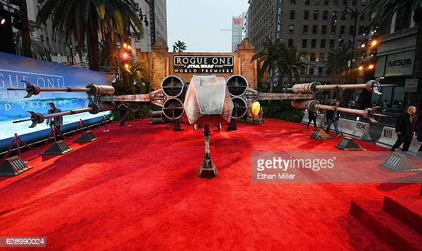 A replica Xwing fighter from the 'Star Wars' movie franchise is parked on the red carpet at the premiere of Walt Disney Pictures and Lucasfilm's...