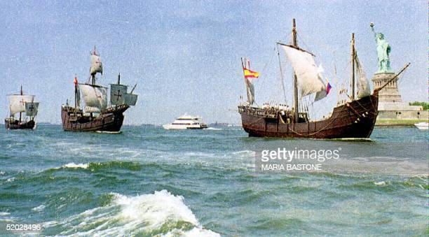 Replicas of Christopher Columbus' ships the Nina Pinta and Santa Maria sail past the Statue of Liberty 26 June 1992 Their tour is sponsored by the...