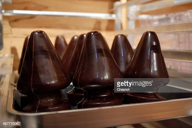 Replicas of the Christmas tree sculpture made of chocolate by Controversial US artist Paul McCarthy are displayed during his 'Chocolate Factory'...