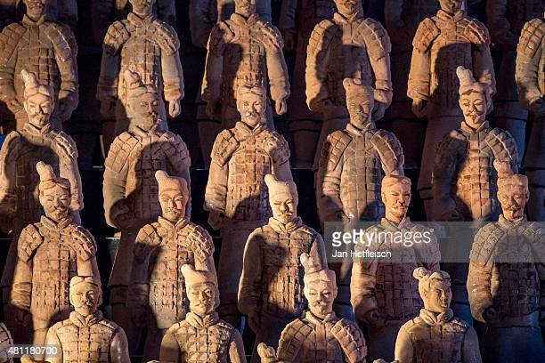 Replications of the Chinese Terracotta Army are seen at the floating stage of the Bregenz opera during a rehearsal for the opera 'Turandot' prior the...