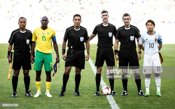 Repo Malepe of South Africa and Daisuke Sakai of Japan pose with the referess prior to the FIFA U20 World Cup Korea Republic 2017 group D match...