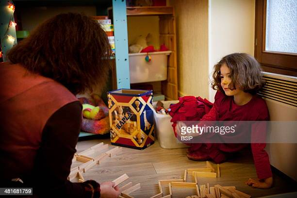 Reportage in a psychopractitioner's practice qualified in the Personcentered Approach in Dourdan France A 6year old girl during a play therapy...