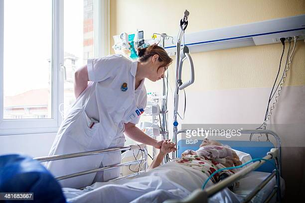 Reportage in Bligny hospital palliative care unit Briis sous Forges France A nurse chats to a patient