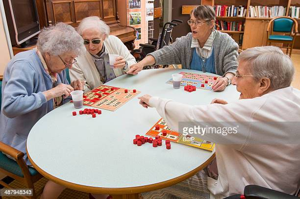 Reportage in the « Accueil » nursing home in Lille France Residents play a game of bingo hosted by an organiser