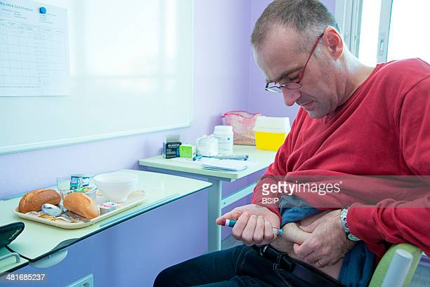 Reportage in the Endocrinology service of Lariboisière hospital in Paris France Injecting insulin before eating breakfast
