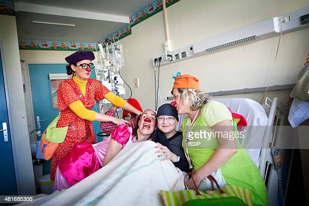 Reportage on the 'Clowns of Hope' charity who offer its services in the Department of Pediatric Hematology in Jeanne de Flandre hospital in Lille...