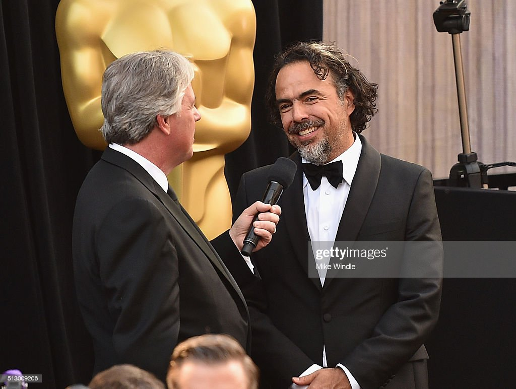 Reporter Chris Connelly (L) interviews filmmaker Alejandro Gonzalez Inarritu during the 88th Annual Academy Awards at Hollywood & Highland Center on February 28, 2016 in Hollywood, California.