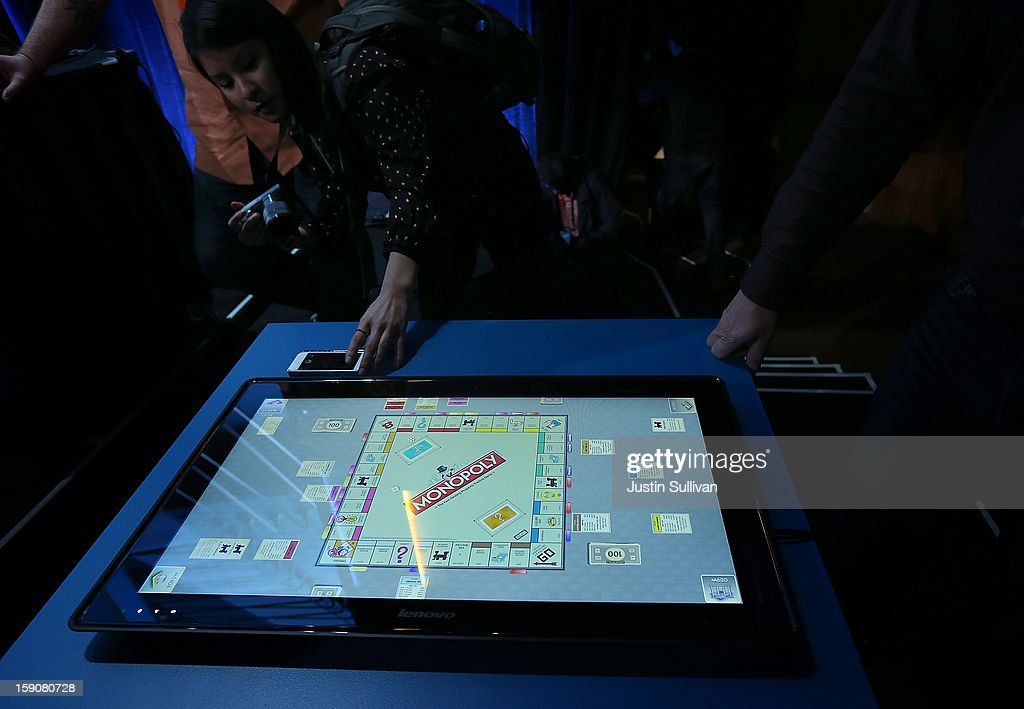 A reporter compares the size of a cell phone to the new Lenovo IdeaCentre Horizon Table PC during an Intel press conference at the 2013 International CES at the Mandalay Bay Convention Center on January 7, 2013 in Las Vegas, Nevada. CES, the world's largest annual consumer technology trade show, runs from January 8-11 and is expected to feature 3,100 exhibitors showing off their latest products and services to about 150,000 attendees.