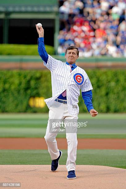 NBA reporter Craig Sager throws out a ceremonial first pitch before the game between the Chicago Cubs and the Los Angeles Dodgers at Wrigley Field on...