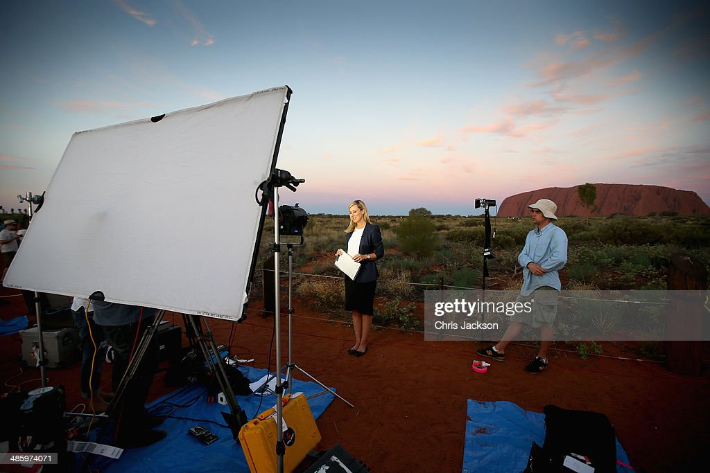 A reporter does a live broadcast at Uluru ahead of a visit by Prince William, Duke of Cambridge and Catherine, Duchess of Cambridge on April 21, 2014 in Ayers Rock, Australia. The Duke and Duchess of Cambridge are on a three-week tour of Australia and New Zealand, the first official trip overseas with their son, Prince George of Cambridge.