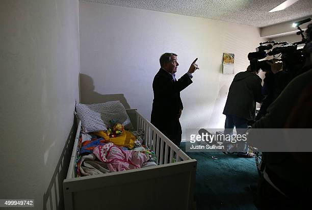 A reporter does a live shot inside the home of shooting suspect Syed Farook on December 4 2015 in Redlands California The San Bernardino community is...