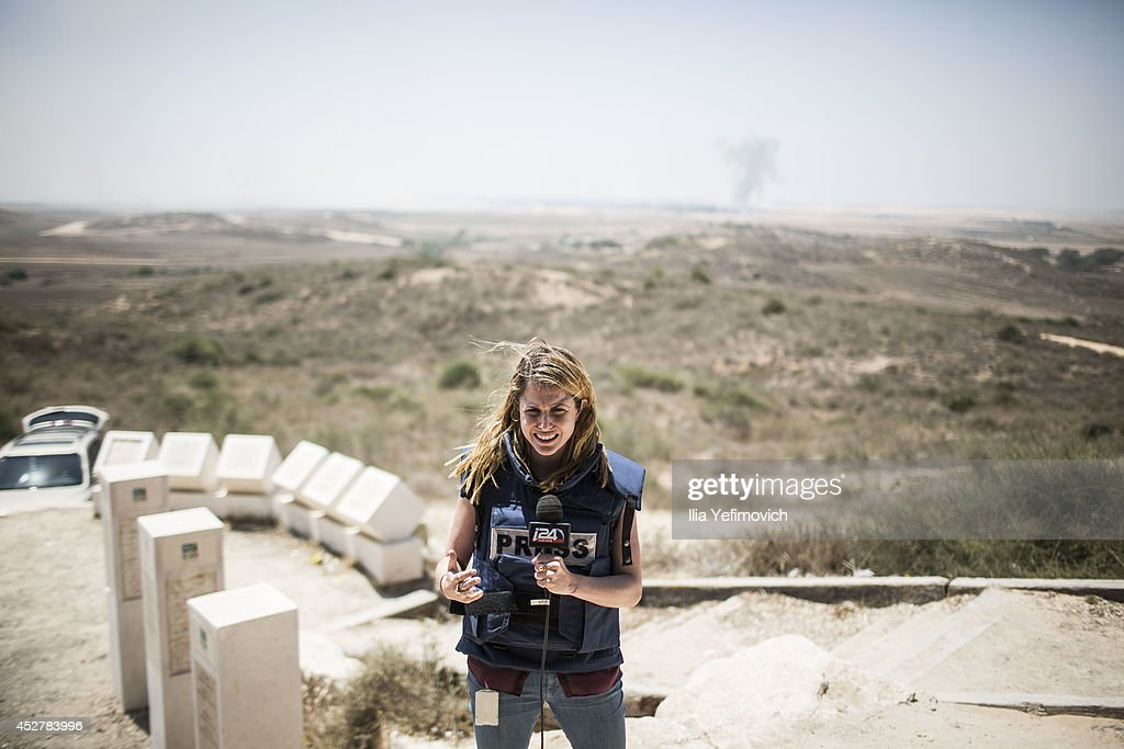 TV reporter does a standup near the border as a 24 hour ceasefire begins on July 27 2014 on the Israeli/Gaza border Israel Fortytwo Israeli soldiers...
