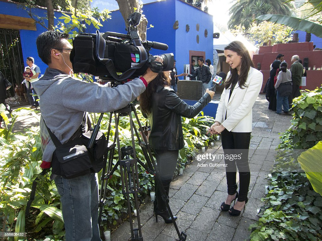 A reporter doing an interview during the presentation of the exhibition Las Apariencias Engañan: The Frida Kahlo Dresses presented by Vogue magazine at Frida Kahlo´s museum on November 21, 2012 in Mexico City, Mexico.