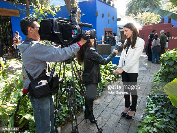A reporter doing an interview during the presentation of the exhibition Las Apariencias Engañan The Frida Kahlo Dresses presented by Vogue magazine...