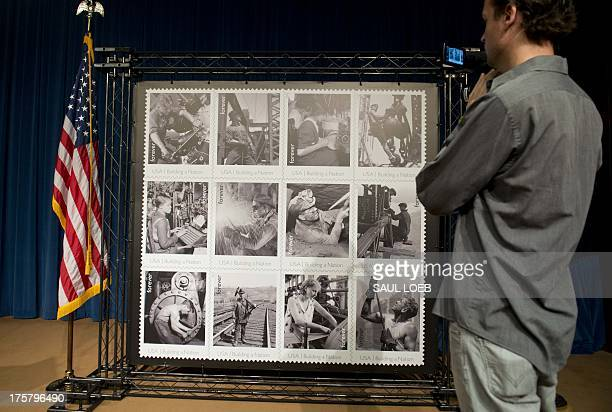 A reporter films new postage stamps titled 'Made in America Building a Nation' at a firstdayofissue event at the Department of Labor in Washington DC...