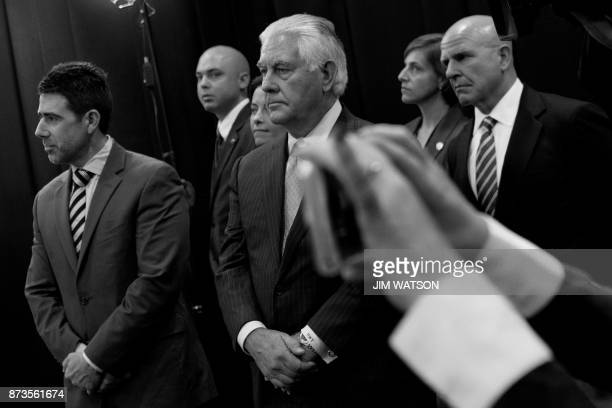 A reporter holds up her cell phone to take a photo as US Secretary of State Rex Tillerson and White House national security adviser HR McMaster as...
