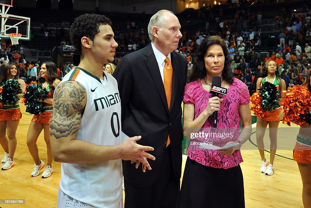 ESPN reporter Jeannine Edwards (R) prepares to interview Shane Larkin #0 and Head Coach Jim Larranaga of the Miami Hurricanes following their game against the North Carolina Tar Heels at the BankUnited Center on February 9, 2013 in Coral Gables, Florida. Miami defeated North Carolina 87-61.