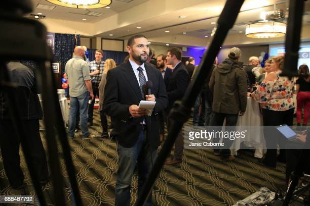 Reporter Ken McGrath with KULR News out of Billings Montana gets ready to broadcast as guests at Republican Greg Gianforte election party wait to...