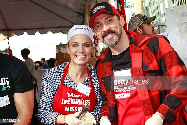 Reporter Michelle Beadle and actor/singer Steve Kazee help serve hot meals at Los Angeles Mission on December 24 2015 in Los Angeles California