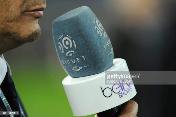 A reporter of Qatar's AlJazeera owned television channel BeIN Sports is seen prior to the French L1 football match Montpellier vs Valenciennes at...