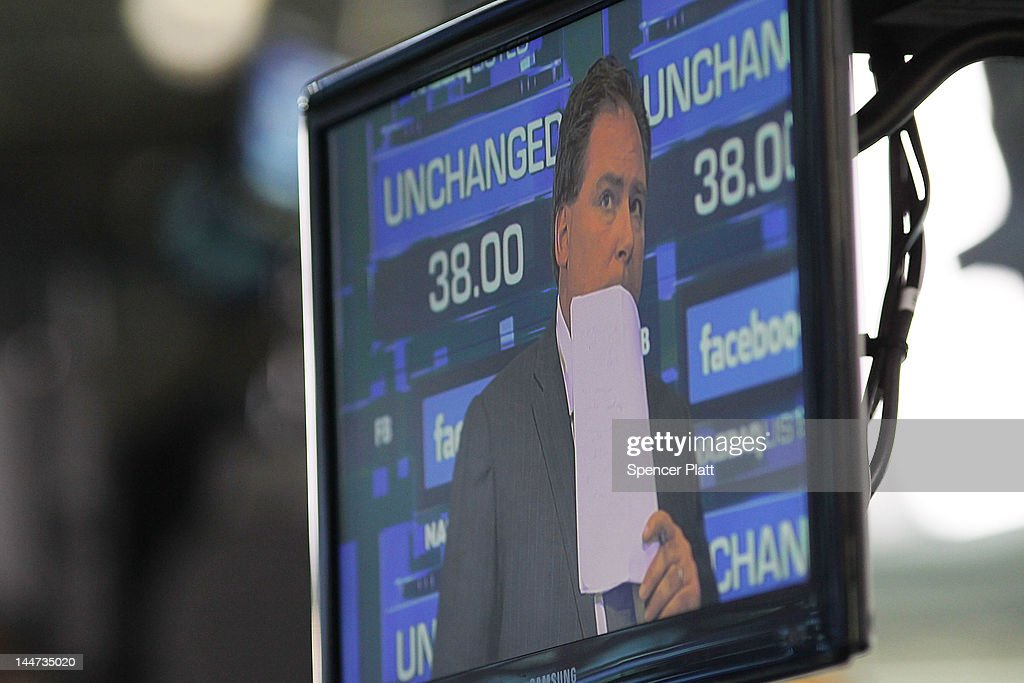 A reporter on a screen waits for the share price of Facebook to start trading at the Nasdaq stock market moments before it went public on May 18, 2012 in New York, United States. The social network site began trading after 11:30 a.m. with shares jumping 13% to $43 before quickly falling. On Thursday Facebook priced 421 million shares at $38 each. Facebook, a Menlo Park, California based company, will have a valuation exceeding $100 billion.