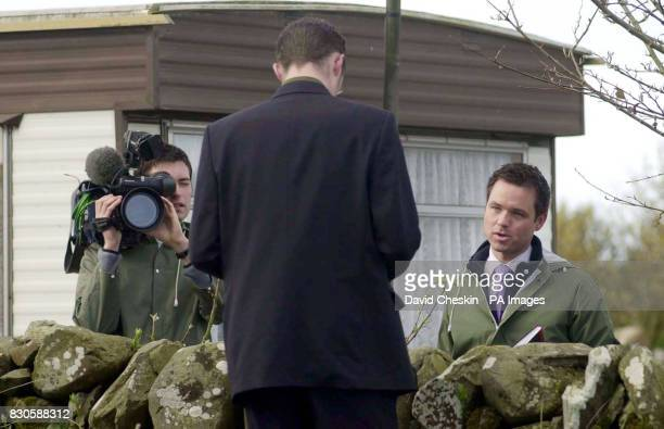 Reporter Peter Lane and cameraman Alastair Thomson a twoman ITN team filming for Channel 5 News talking to an unidentified newspaper reporter at the...