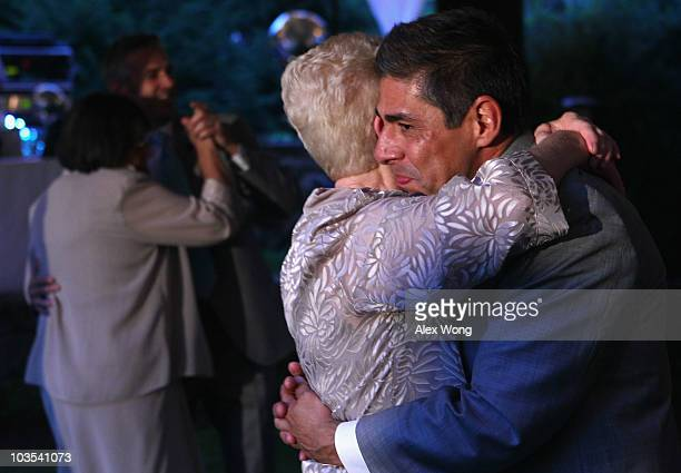 TV reporter Roby Chavez and his newly wedded husband Chris Roe dance with each others mothers Lydia Griffin and Karen during their wedding ceremony...